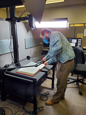 Man scans archival records
